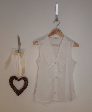 Weiße ärmellose Bluse mit Volants