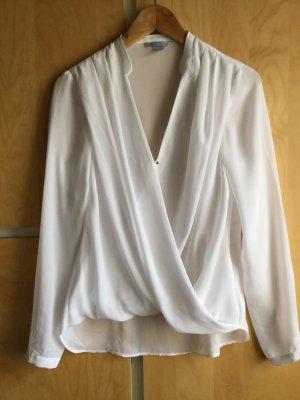 Weiße Bluse in Wickeloptik