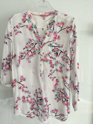 Weiße Bluse mir floralem Muster in Türkis/Pink