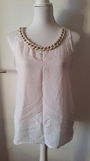 Weiße Bluse mit angenähter Kette
