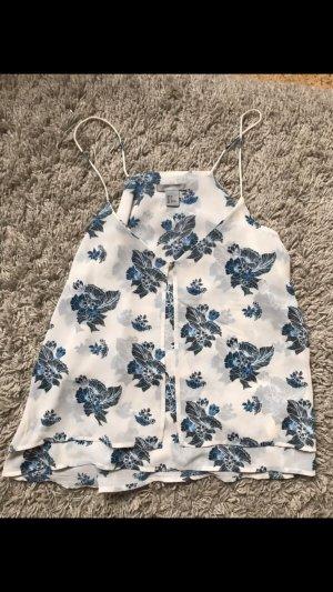 Weiße Bluse mit blauem Blumenmuster