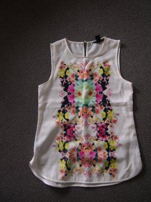 Weiße Bluse mit Blumenaufdruck (vorne)