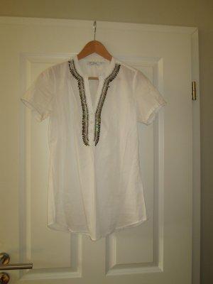 weiße Bluse mit goldfarbigen Pailletten