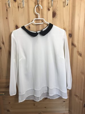 Cuello de blusa blanco-negro