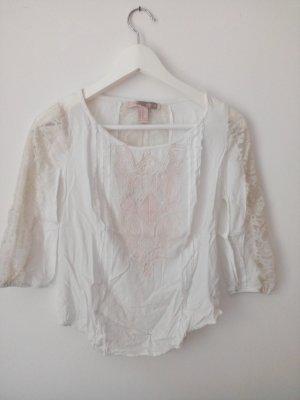 Weiße Bluse mit rosefarbener Stickerei