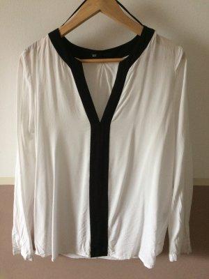 Weiße Bluse mit schwarzen Details
