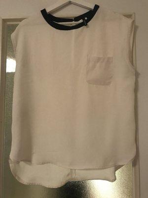 Weiße Bluse mit schwarzen Kragen