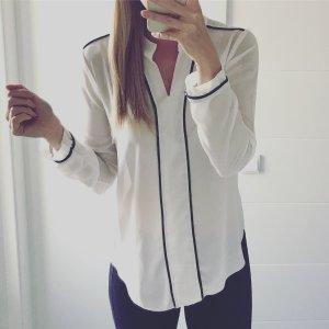 weiße Bluse mit schwarzen Streifen