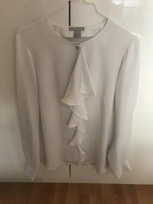 Weiße Bluse mit Volant