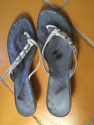 Weiße Flipflops Schuhe