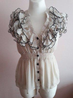 Weiße, gepunktete Bluse mit Rüschen