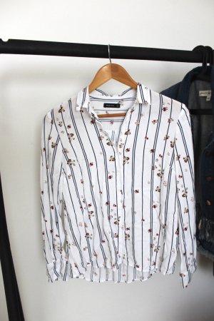 Weiße Hemdbluse mit Streifen und Muster