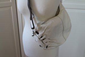 Weiße Lederhandtasche mit braunem Tragriemen