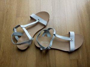 Weiße Lederriemchen-Sandalen