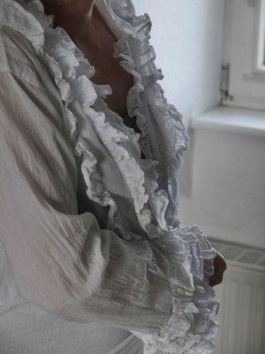 Weiße leicht transparente Wickelbluse