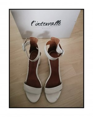 Sandalias de tacón de tiras blanco Cuero