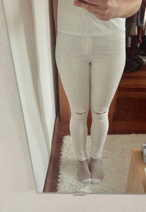 Weiße Skinny Jeans mit Rissen am Knie Gr. 38