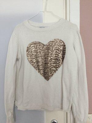 Weißer Pullover mit Herz aus Pailetten