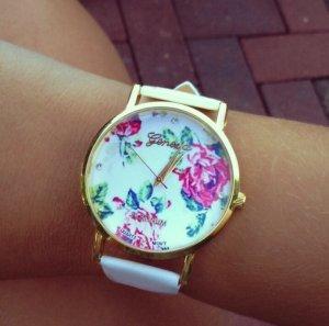 Weißes blumen Uhr neu