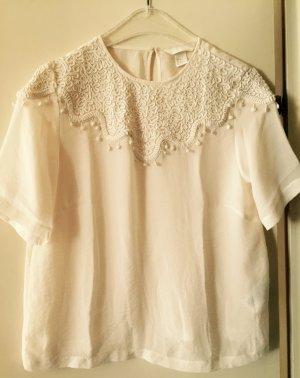 Weißes Blusenshirt mit Stickerei