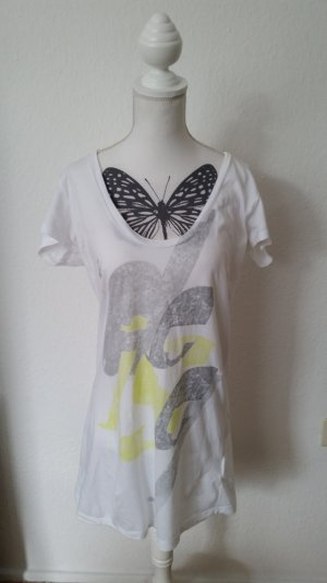 Weißes langes Diesel T-shirt mit weitem Ausschnitt und Print in grau und gelb.
