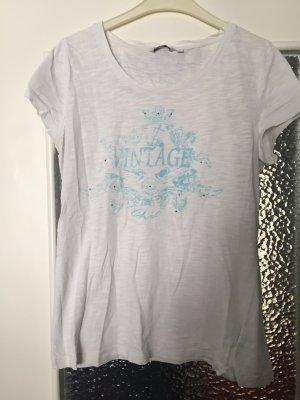 Weißes Shirt mit Aufdruck und Glitzersteinen