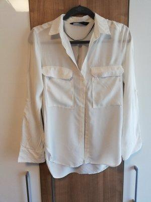Weißes Shirt mit großen Taschen