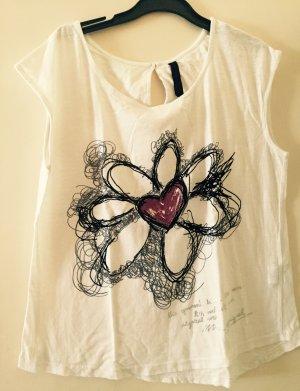 Weißes T-Shirt mit einer Blume von Desigual