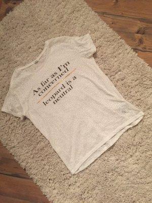 Weißes T-shirt mit goldenen Aufdruck