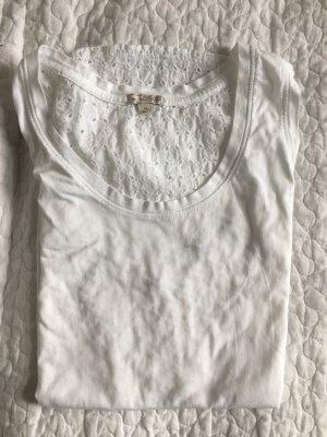 Weißes Top mit Muster am Rücken