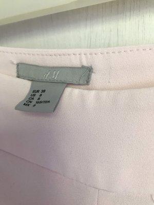 H&M Pantalon pattes d'éléphant rosé