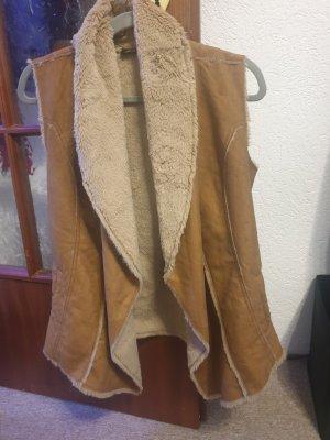 Chaleco de piel marrón claro