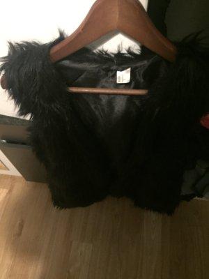 H&M Smanicato di pelliccia nero Pelliccia