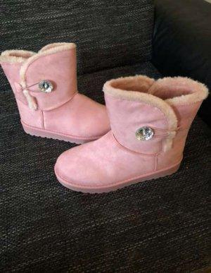 Bottes de neige rose