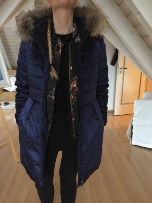 Wintermantel in metallicblau/lila