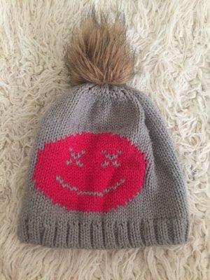 Bonnet en crochet gris-rose