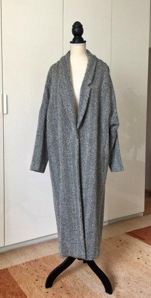 Wollmantel von Mango Suit. Fischgrät-Muster/Salz und Pfeffer.