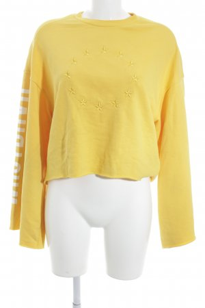 WRSTBHVR Suéter amarillo oscuro look casual