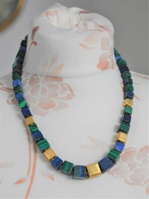 Collar color oro-azul acero