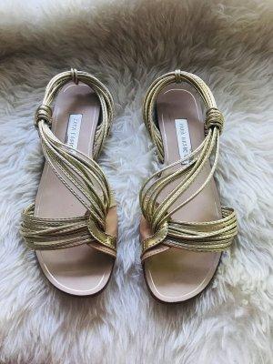 Wunderschöne goldfarbene Sandalen