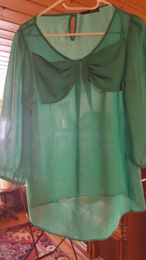wunderschöne grün leuchtende Bluse