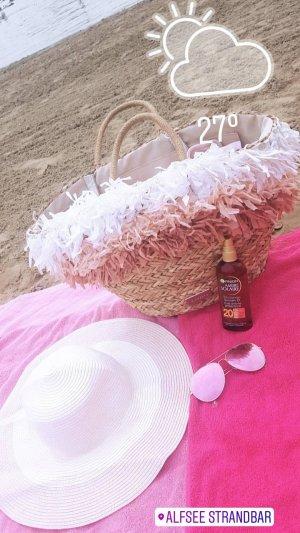 Sombrero de ala ancha color rosa dorado-crema