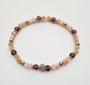 wunderschönes Armband in Apricottönen mit silberfarbenen Zwischenperlen und Herz