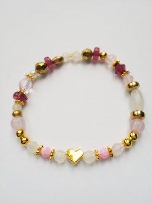 wunderschönes Armband mit lila- und rosafarbenen, weißen und goldenen Perlen sowie Herzperle