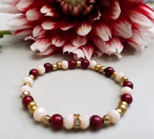 Wunderschönes Armband mit rot & cremefarb. Glasschliffperlen & goldf. Elementen