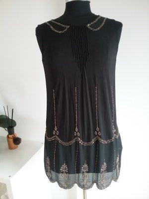Next Mini vestido negro-color oro tejido mezclado