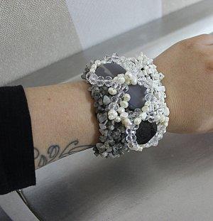 Ornamento braccia bianco-grigio