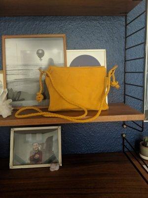 Yellow suede cross body bag