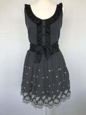 Yumi Kleid Pinup 50er Style schwarz weiß getupft mit Blumen
