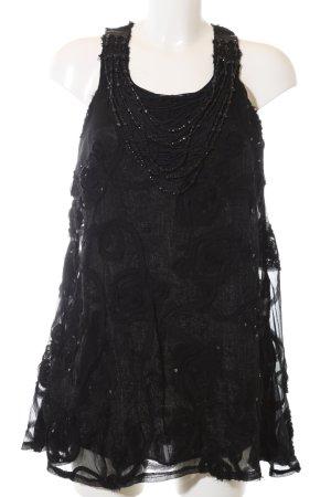 Yumi Top largo negro estampado floral elegante